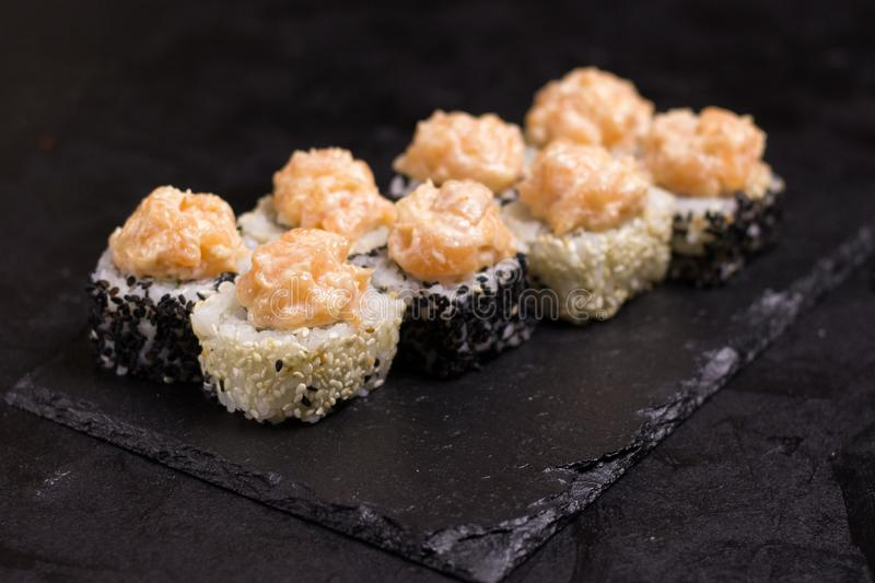 Sushi roll with cream cheese, sesame. Japanese food royalty free stock photo