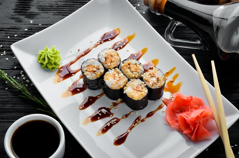 Sushi roll with fish eel and sesame seeds. Chinese traditional dish. Top view. Free copy space stock image