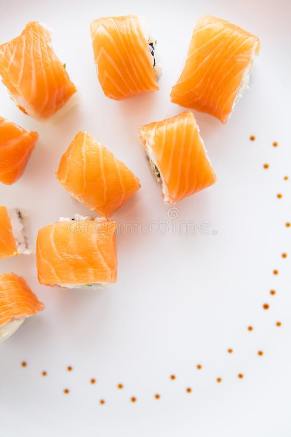 Sushi roll with salmon, philadelphia on a white plate, top view. Close-up royalty free stock photography