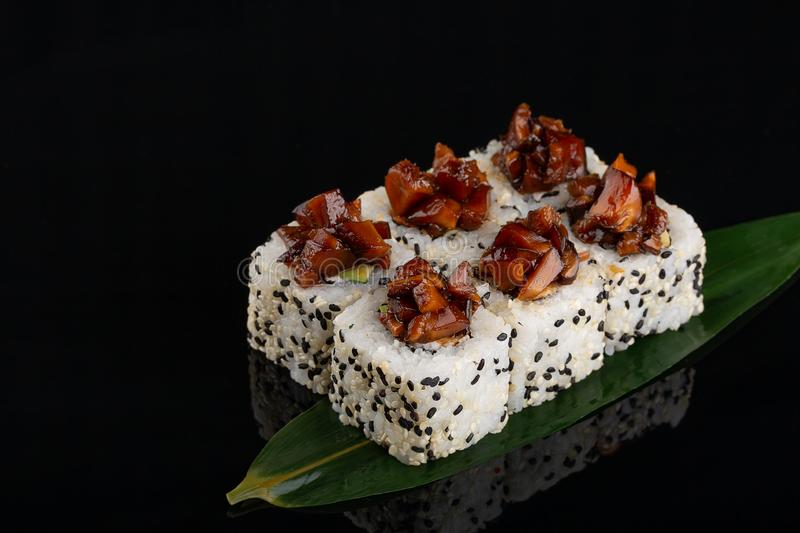 Sushi roll set with sesame and caramel soy sauce stock images
