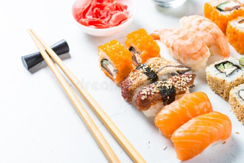 Sushi and sushi roll set on white table. stock image