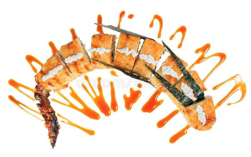 Sushi roll in the shape of a dragon. Isolated on white background. Creative dish for menu stock photo