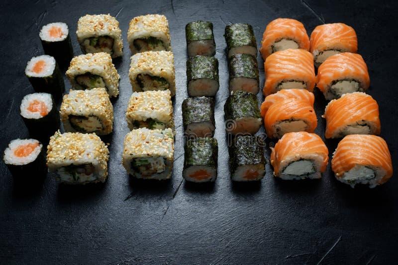 Sushi rolls assortment japanese food craft bar royalty free stock photos