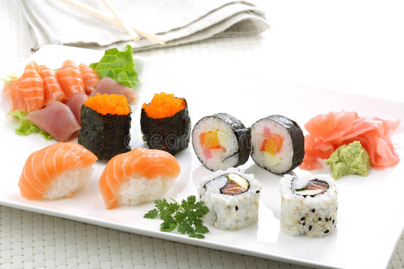 Sushi rolls dish. On a table stock photography
