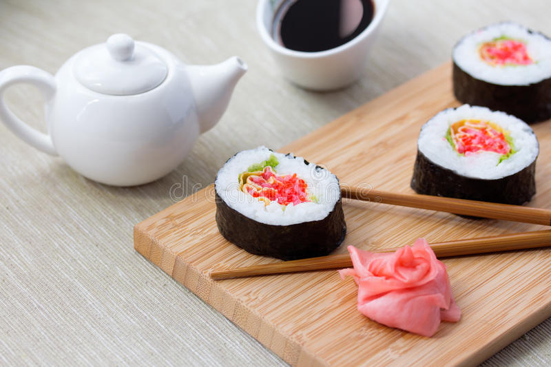 Sushi rolls with ginger, soy sauce and chopsticks stock images