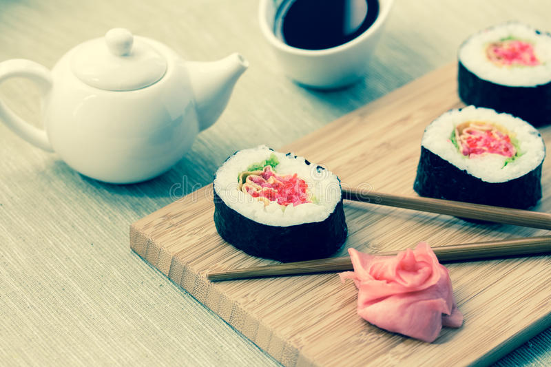 Sushi rolls with ginger, soy sauce and chopsticks royalty free stock photos
