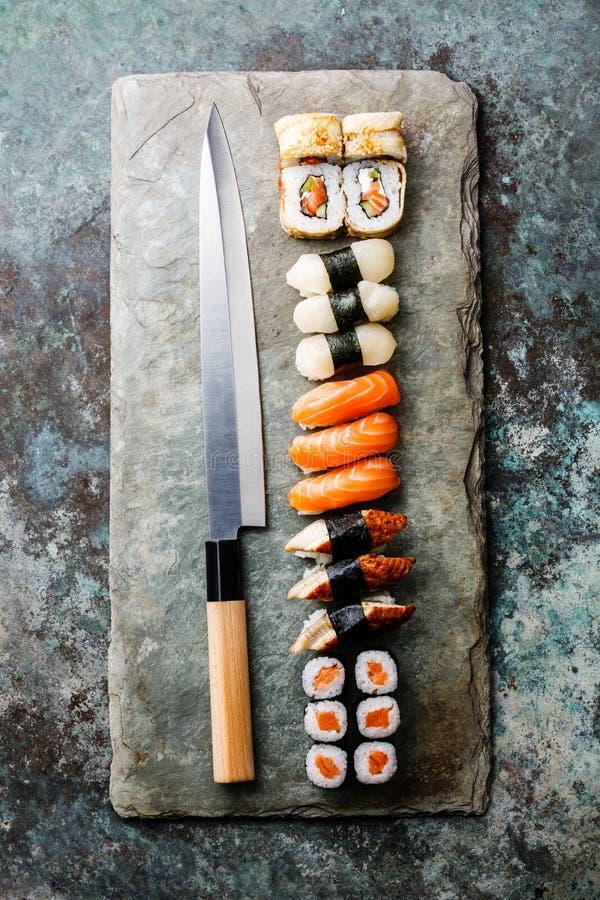 Sushi rolls and nigiri with Japanese knife royalty free stock image
