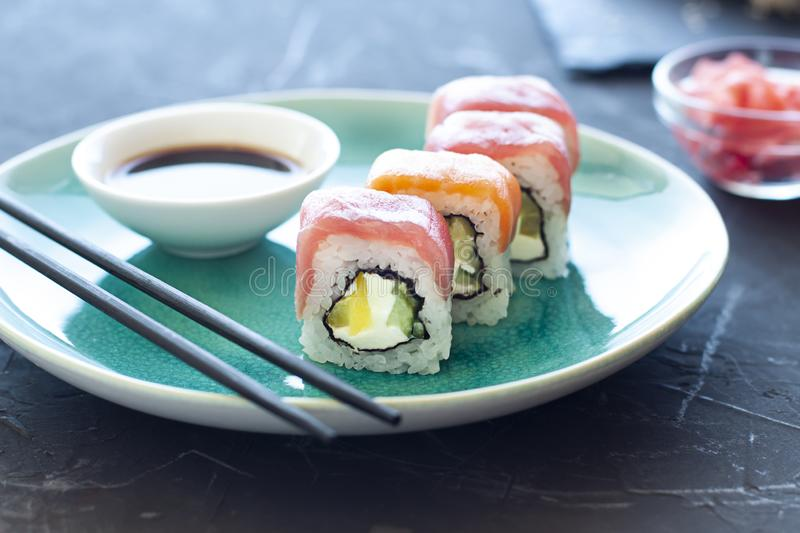 Sushi rolls on the plate with soy sauce and chopsticks. Japanese food royalty free stock image