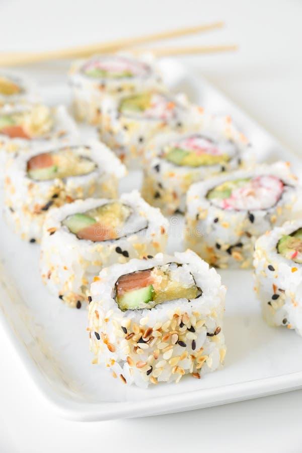 Sushi rolls sake tempura royalty free stock photography