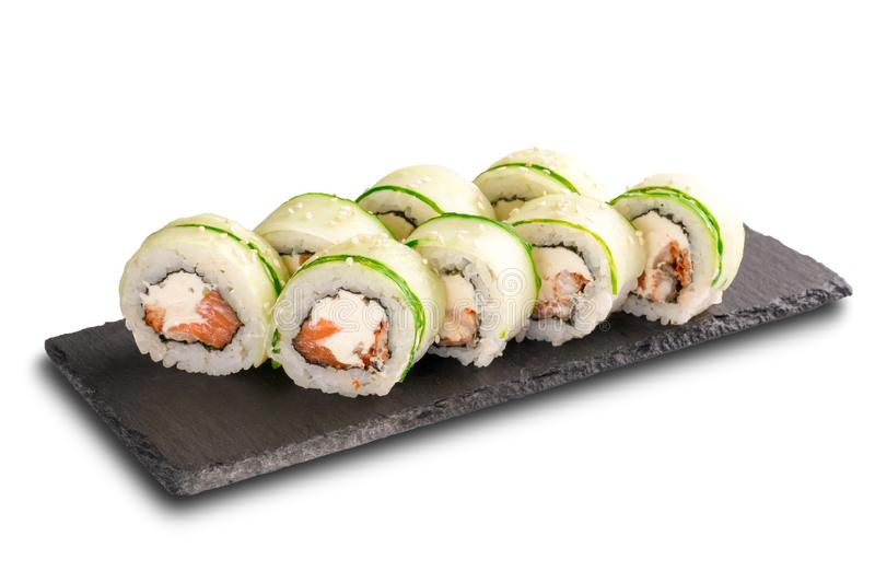 Sushi Rolls with salmon, cucumber, nori leaf and Cream Cheese inside on black slate or stone shale surface isolated. On white background stock images