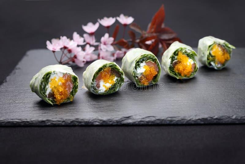 Sushi rolls with salmon, rucola, philadelphia cheese. stock photos