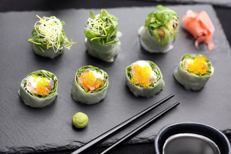 Sushi rolls with salmon, rucola, philadelphia cheese. royalty free stock photo