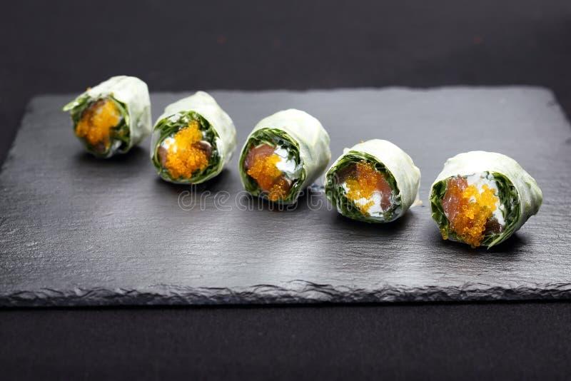 Sushi,  sushi rolls with salmon, rucola, philadelphia cheese. royalty free stock photos