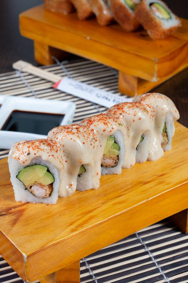 Sushi rolls served in wood - Image stock image