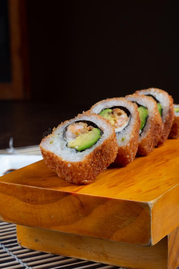 Sushi rolls served in wood - Image stock photography