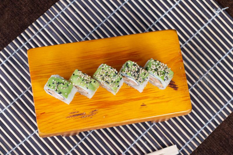 Sushi rolls served in wood - Image stock photo