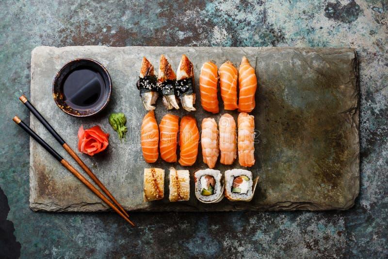 Sushi rolls set on stone slate stock images