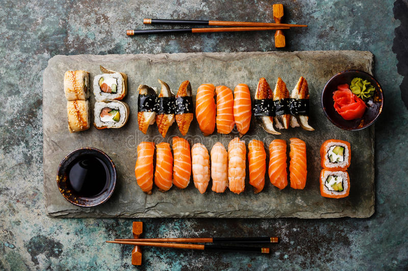 Sushi rolls set for two on stone slate stock photo