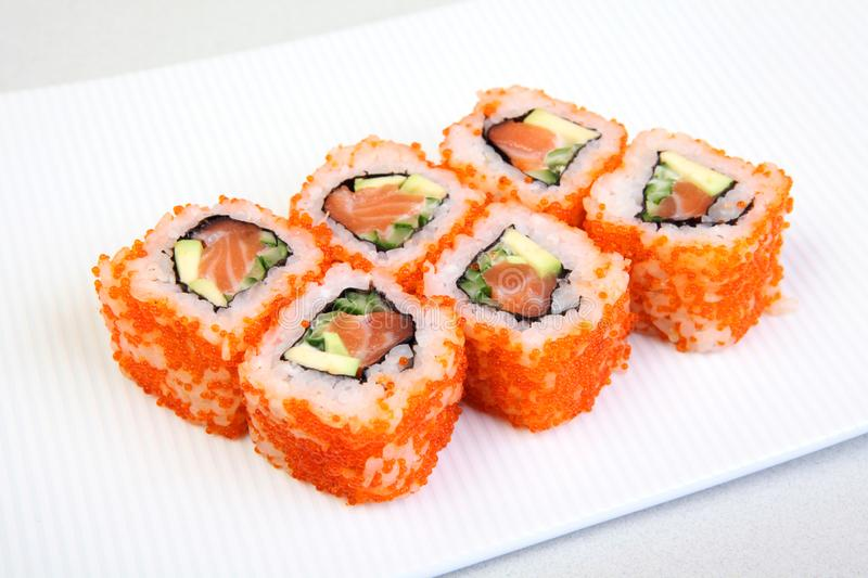 Sushi. Rolls with shrimp. Roll California with avocado. Japanese food. Healthy food is nicely laid out on a platter. royalty free stock photography
