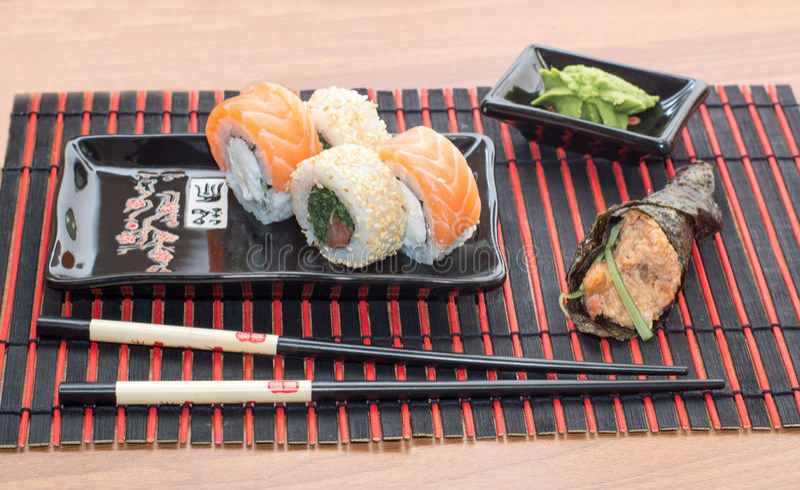 Sushi rolls with sticks stock photo
