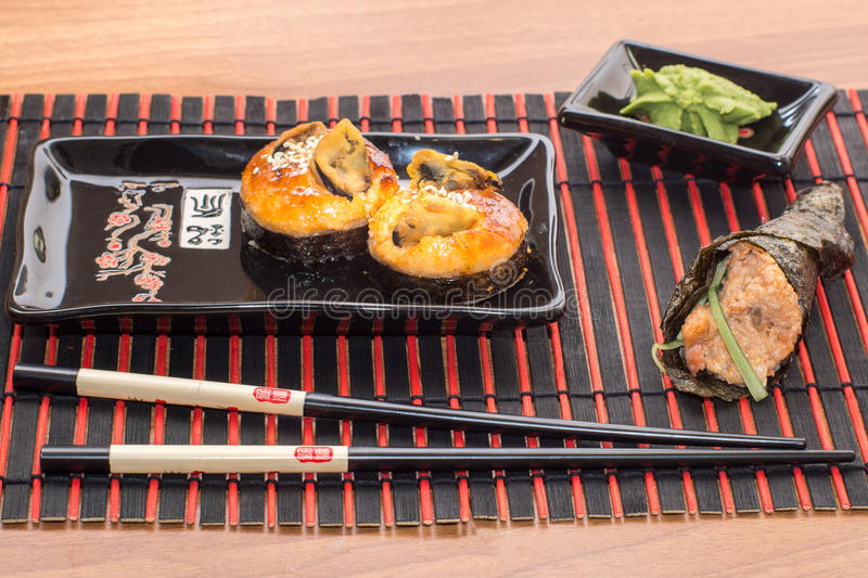 Sushi rolls with sticks royalty free stock image