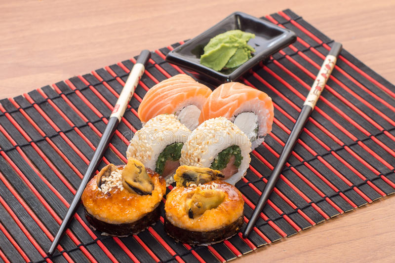 Sushi rolls with sticks royalty free stock photos