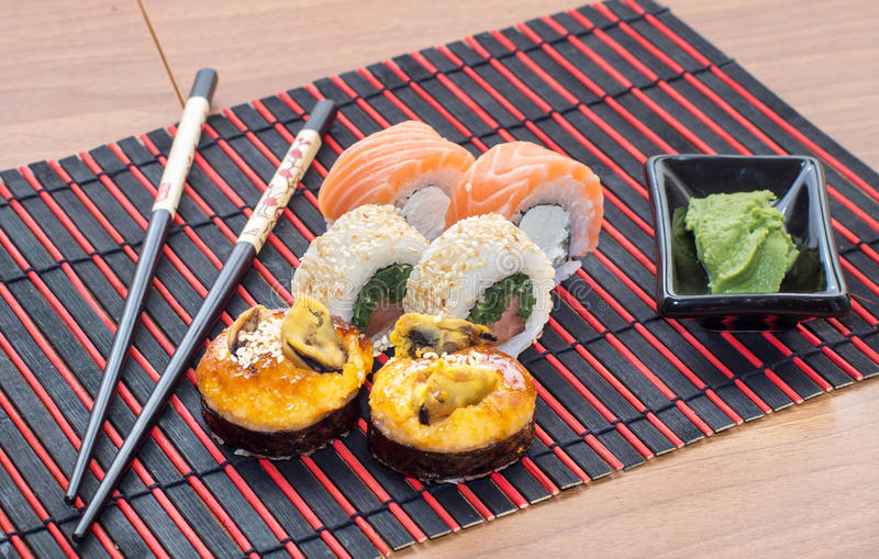 Sushi rolls with sticks stock photos