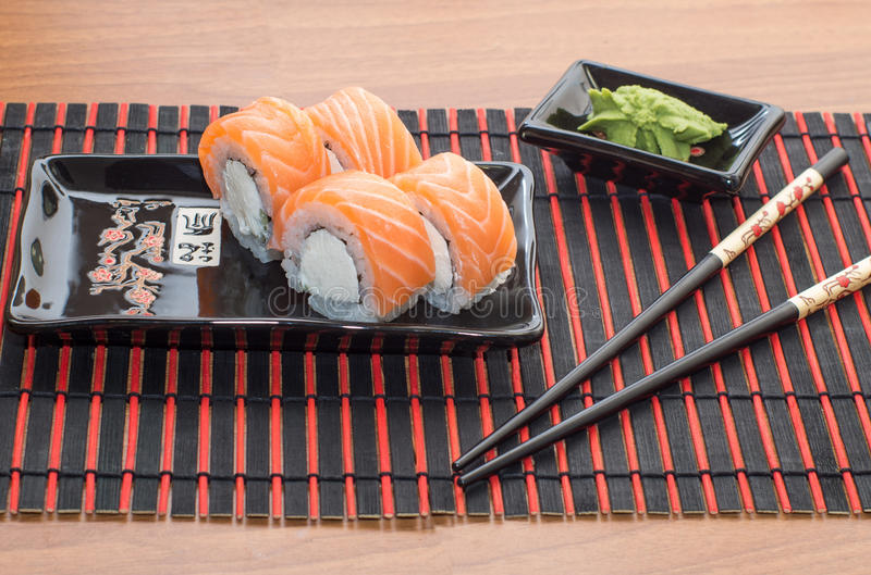 Sushi rolls with sticks royalty free stock photo