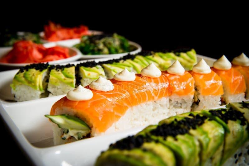 Sushi rolls table setting stock photos