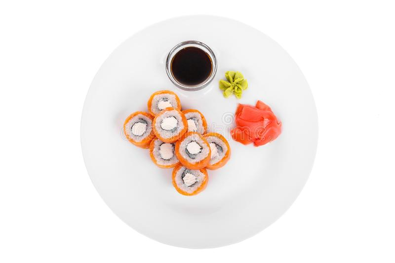 Sushi, rolls on a white isolated background. Sushi, rolls, uramaki, philadelphia, with salmon, crab meat, cheese, raw seafood, soy sauce, marinated ginger and royalty free stock photo