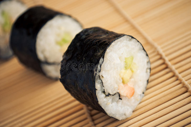 Sushi rolls. On a wooden surface stock images
