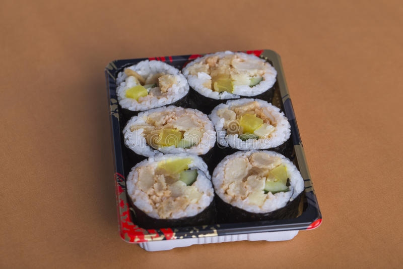 Sushi rolls on the yellow table. royalty free stock images
