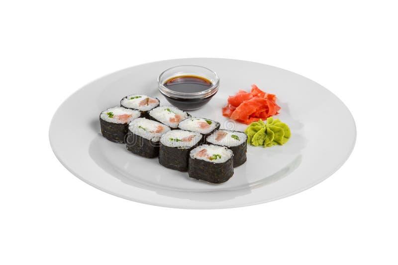 Sushi rullar p? en vit isolerade bakgrund royaltyfria foton
