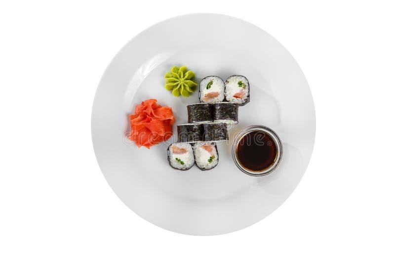 Sushi rullar p? en vit isolerade bakgrund royaltyfria bilder