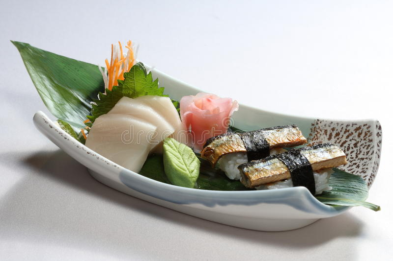 Sushi and sashimi. A serving of sushi and sashimi stock image