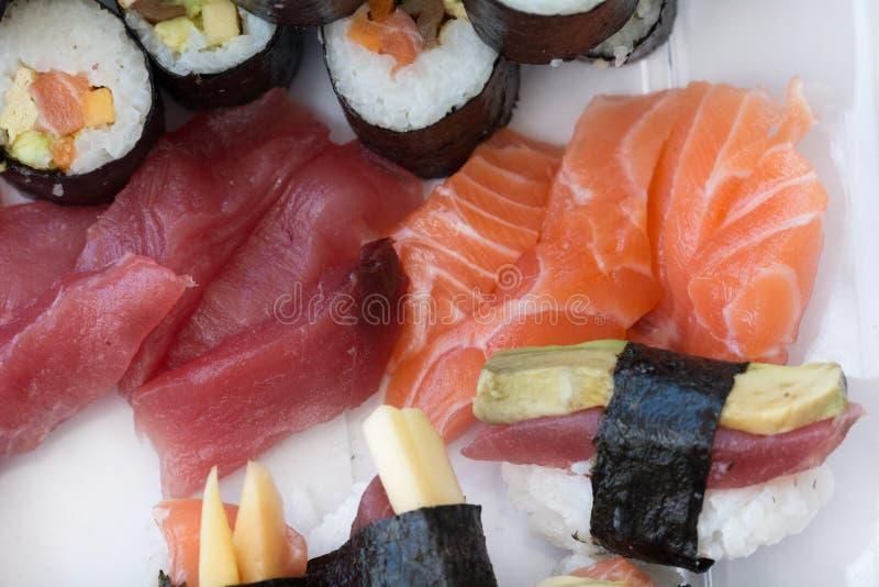Sushi sashimi nigiri and maki rolls, isolated on white royalty free stock photography