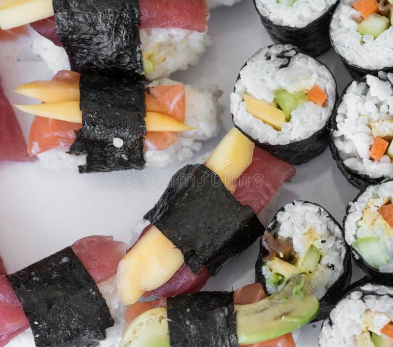 Sushi sashimi nigiri and maki rolls, isolated on white stock images
