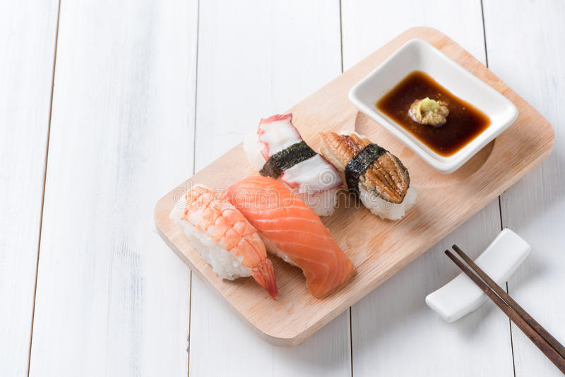 Sushi with sauce and wasabi on wood plate stock image