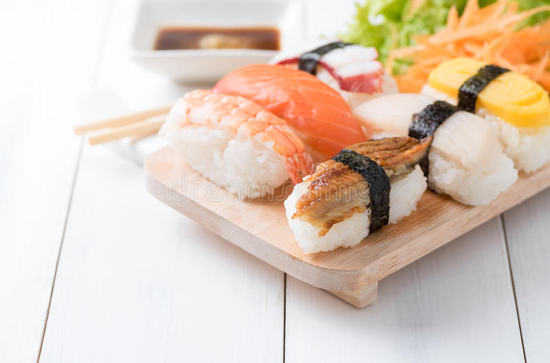 Sushi with sauce and wasabi on wood plate royalty free stock photo