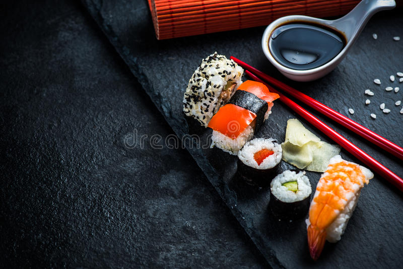 Sushi selection on black slate stock photos