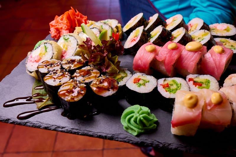 Sushi Set on black stone slate royalty free stock photos