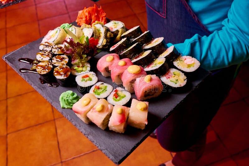 Sushi Set on black stone slate. Close-up royalty free stock photo