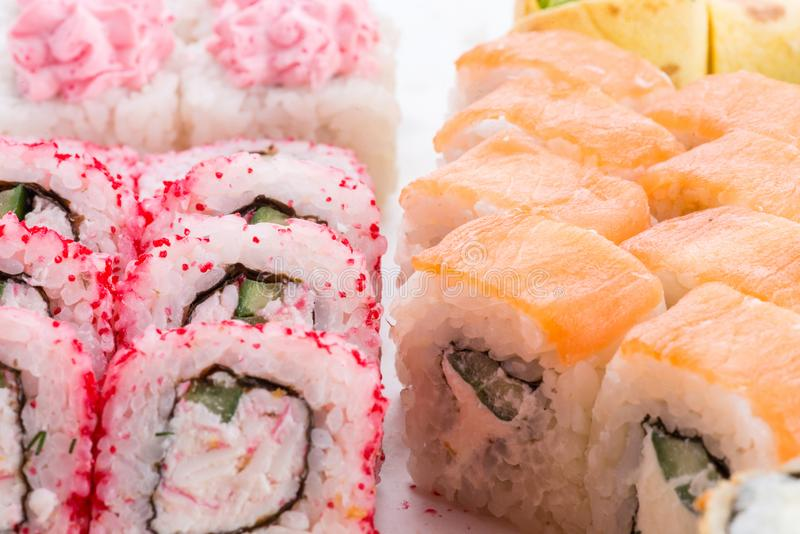 Japanese food restaurant, sushi maki gunkan roll plate or platter set. Sushi set and composition. Sushi set and composition at white background. Japanese food royalty free stock image