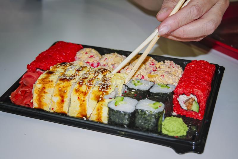 Sushi set with different roles on a black plate close-up royalty free stock photos
