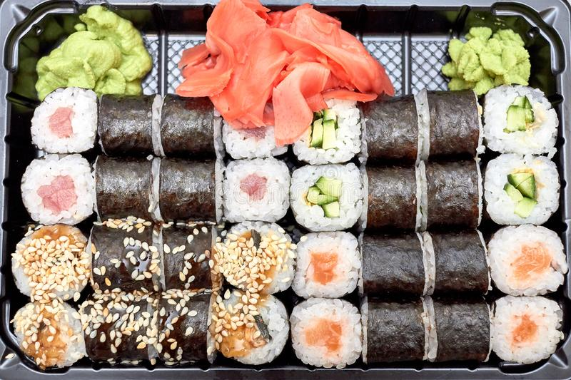 Sushi set. Set of different sushi with seafood. Sushi rolls with different fillings. A dish of traditional Japanese cuisine. Rolls. With a variety of seafood royalty free stock images