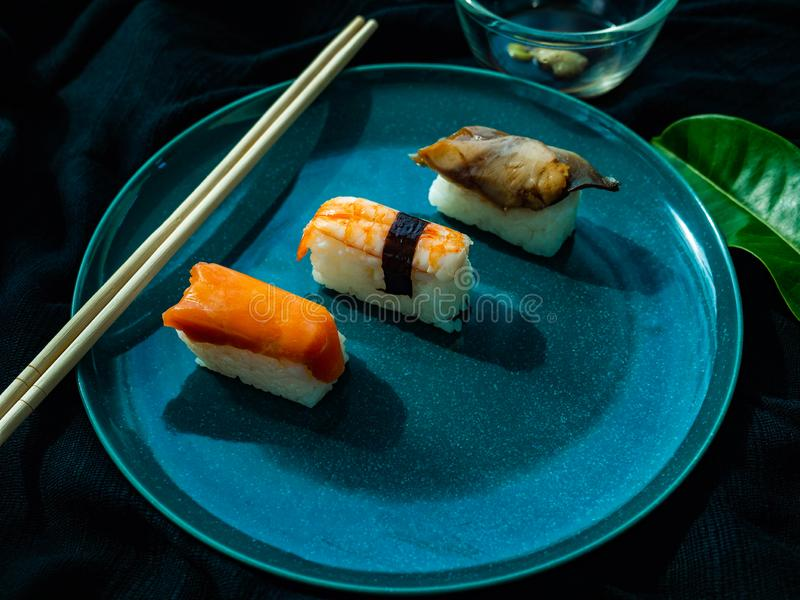 Sushi set on dish with Shrimp Salmon Saba,Japanese food is good health,Color black background,Black cloth foundation stock photography