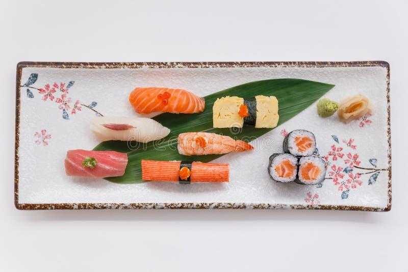 Sushi Set Include Maguro, Hamachi, Salmon, Kani, Shrimp, Tamagoyaki and Salmon Maki Roll. Sushi Set Include Maguro, Hamachi, Salmon, Kani, Shrimp, Tamagoyaki stock photo