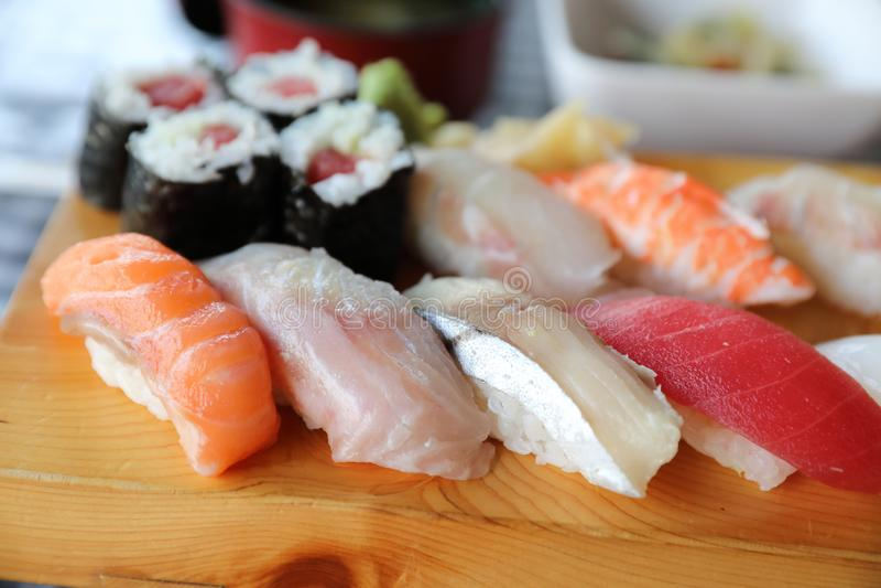 Sushi Set nigiri and sushi maki with tea , Japanese food royalty free stock photography
