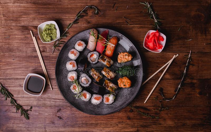 Sushi set nigiri and rolls served on brown wooden table background. Top view food photography stock photos