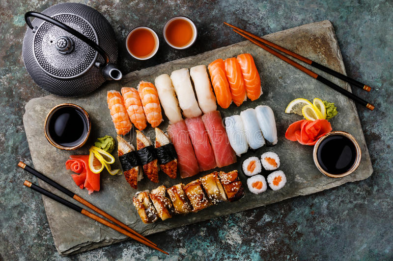 Sushi Set nigiri and sushi rolls with tea for two stock image